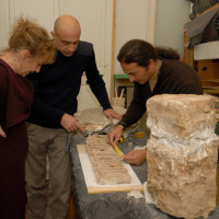 R. Giunta, D. Marletto and F. Colombo discussing the conservation of brick finds at the MNAO, 2008 ©IsIAO archives Ghazni/Tapa Sardar Project 2014