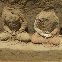 Fig. 30 - Zone 14: Buddhas no. 5 (to the left), and no. 4 (showing traces of restauration with red clay)