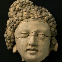 Head of deva from Niche 76, with traces of red paint on the eyebrows and black paint in the hair - TS 1871