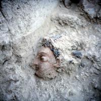 Excavation of a bodhisattva head still preserving the original painting