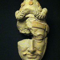 Moustached head of a Kushan aristocrat with conical cap - TS 1065 + TS 1515