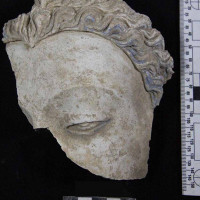 Fig. 25 - Buddha head with traces of blue paint on the hair and eyes from Chapel 4 (TN CH 4 no. 35)